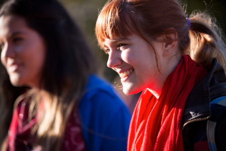 Female student outside wearing red scarf
